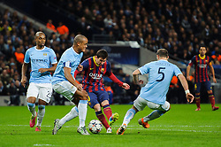 Barcelona Midfielder Lionel Messi (ARG) is challenged by Man City Defender Vincent Kompany (BEL) - Photo mandatory by-line: Rogan Thomson/JMP - Tel: 07966 386802 - 18/02/2014 - SPORT - FOOTBALL - Etihad Stadium, Manchester - Manchester City v Barcelona - UEFA Champions League, Round of 16, First leg.