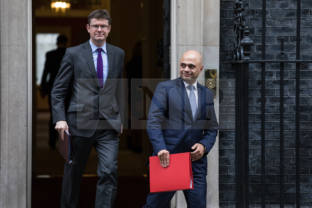 © Licensed to London News Pictures. 14/11/2017. London, UK. Secretary of State for Business, Energy and Industrial Strategy Greg Clark (L) and Secretary of State for Communities and Local Government Sajid Javid (R) leave 10 Downing Street after the weekly Cabinet meeting. Photo credit: Rob Pinney/LNP