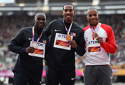 USA's Christain Taylor (centre, gold), USA's Will Claye (left, Silver) and Portugal's Nelson Evora celebrate during the medal ceremony for the men's Triple Jump during day eight of the 2017 IAAF World Championships at the London Stadium.