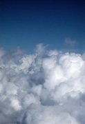 Looking down on cumulous clouds from above.