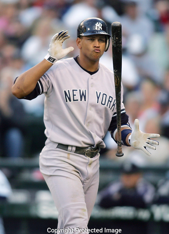 New York Yankees'Alex Rodriguez reacts after striking out against the Seattle Mariners. (AP Photo/John Froschauer).
