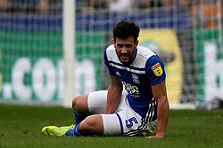 Birmingham City's Maxime Colin appears injured on the floor