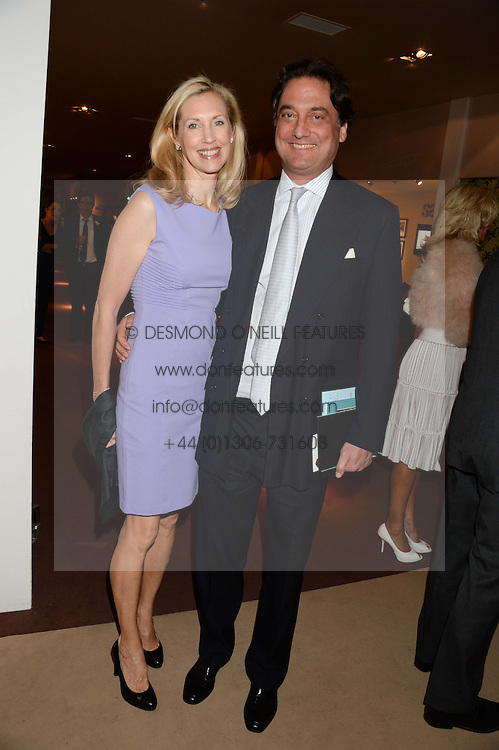 COUNT & COUNTESS ALLESANDRO GUERRINI-MARALDI at the Masterpiece Midsummer Party in aid of Marie Curie Cancer Care held at The Royal Hospital Chelsea, London on 2nd July 2013.