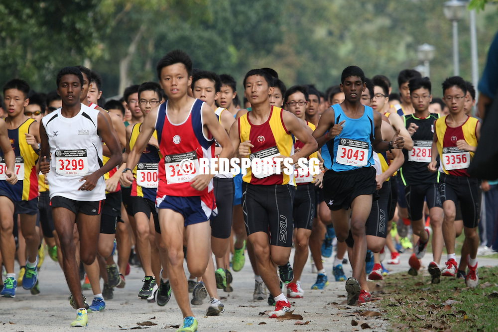 Bedok Reservoir Park, Wednesday, March 27, 2013 — Leroi Lee of Nan Hua High breezed past his competitors to claim the B Division gold at the 54th National Schools Cross Country Championships. He ran the 4.3-kilometre route in a time of 14 minutes 5 seconds.<br /> <br /> Story: http://www.redsports.sg/2013/03/27/cross-country-b-boys-leroi-lee-nan-hua-high/