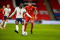LONDON, ENGLAND - Thursday, October 8, 2020: England's Ainsley Maitland-Niles (L) and Wales' Neco Williams during the International Friendly match between England and Wales at Wembley Stadium. The game was played behind closed doors due to the UK Government's social distancing laws prohibiting supporters from attending events inside stadiums as a result of the Coronavirus Pandemic. England won 3-0. (Pic by David Rawcliffe/Propaganda)