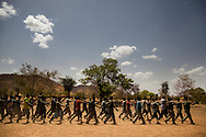 New trainees march during drills at a training camp in the Nuba mountains. The SPLA says it refuses to allow anyone to join the army under 18, although some have tried. Many of the young men in the army were students before the war broke out.