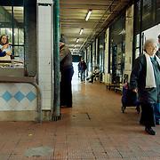 Elderly couple leaving the fishmongers section of Ribeira market