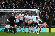 Mesut Ozil of Arsenal (L) takes a free kick which is blocked by the  Tottenham Hotspur players in wall. Premier league match, Tottenham Hotspur v Arsenal at Wembley Stadium in London on Saturday 10th February 2018.<br /> pic by Steffan Bowen, Andrew Orchard sports photography.