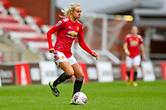 Manchester United defender Millie Turner (21) looks for a pass during the FA Women's Super League match between Manchester United Women and Reading LFC at Leigh Sports Village, Leigh, United Kingdom on 7 February 2021.