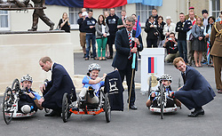 The Duke of Cambridge and Prince Harry talk to wounded service personnel before they set off on the 2013 Hero Ride during a visit to the Help For Heroes Recovery Centre in Tidworth, Wiltshire, Monday, 20th May 2013 Picture by:  Stephen Lock / i-Images