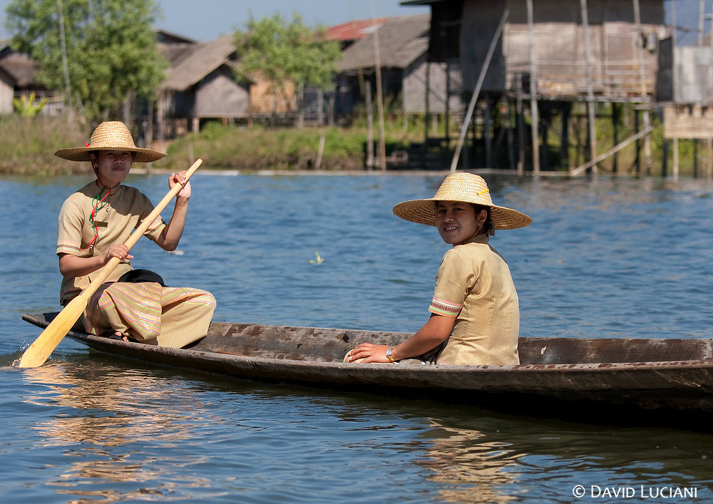 An oncoming boat steered by two young burmese ladies.