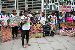 London, UK. 10 July, 2019. Eulalee, a 60-year-old descendant of the Windrush generation, addresses campaigners from groups including Movement for Justice and Out and Proud protesting outside the Home Office against the government department's decision to try to block the return to the UK of PN, a Ugandan lesbian removed from the UK using the now unlawful fast track procedure in 2013 but who the High Court ordered on 24th June must be returned to the UK by the Home Office after the handling of her case was ruled to be 'procedurally unfair'.