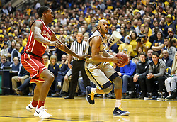 Jan 6, 2018; Morgantown, WV, USA; West Virginia Mountaineers guard Jevon Carter (2) drives towards the basket during the second half against the Oklahoma Sooners at WVU Coliseum. Mandatory Credit: Ben Queen-USA TODAY Sports