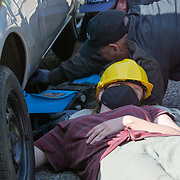 2021-09-07 ExCeL London, UK. Desi activists block approach road to east gate excel london lock themselves through a pipe under a car. Solidarity with Afghanistan - Stop the Arms Fair migrants and refugees are welcomed, not arms dealers.