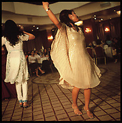 Young women dance at a wedding party in Kabul.