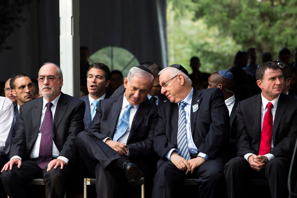 Israeli Prime Minister Benjamin Netanyahu (front row 2nd L) talks with Israeli President Reuven Rivlin (2nd R) as President of the Supreme Court of Israel Asher Grunis (L) and Speaker of the Knesset, the Israeli parliament, Yuli Edelstein (R) look on, during a memorial ceremony marking 19 years since prime minister Yitzhak Rabin was assassinated, at the Mount Herzl military cemetery in Jerusalem, Israel, on November 5, 2014. Rabin was shot and killed by a right-wing Jewish extremist on November 4, 1995 during a peace rally.