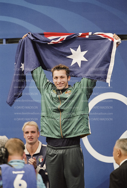 SYDNEY - SEPTEMBER 16:  Ian Thorpe of Australia celebrates his win in the Men's 400 meter Freestyle swimming event of the 2000 Olympic Games on September 16, 2000 at the Sydney International Aquatic Center in Sydney, Australia.  Thorpe set a new world record in the event. (Photo by David Madison/Getty Images)