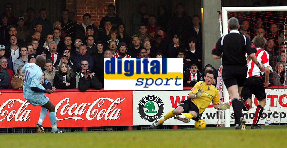 Photo: Frances Leader.<br />Brentford v Chesterfield. Coca Cola League 1. <br />10/12/2005.<br />Chesterfield's Paul Hall (L) scores the only goal of the first half.