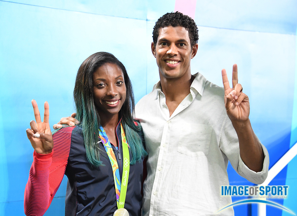 Aug 18, 2016; Rio de Janeiro, Brazil; Nia Ali (USA), left, poses with silver medal and coach Ryan Wilson after placing second in the women's 100m hurdles during the 2016 Rio Olympics at Estadio Olimpico Joao Havelange.