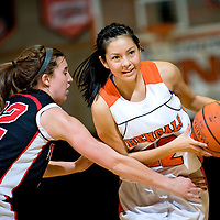 011913  Adron Gardner/Independent<br /> <br /> Grants Pirate Haley Hall (22), left, tries to keep up with Gallup Bengal Kaylee Tsinginie (12) on a drive at Gallup High School Tuesday.