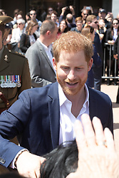 AU_1369901 - Sydney, AUSTRALIA  -  Prince Harry and Meghan tour Opera House, Taronga Zoo after baby news. Royal watchers swamp Opera House for Meghan Markle and Prince Harry's first day on tour downunder.<br />