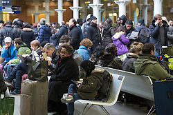 © licensed to London News Pictures. London, UK 12/03/2013. Stranded Eurostar passengers waiting at St Pancras Station in London as the train services cancelled due to weather conditions in north of France. Photo credit: Tolga Akmen/LNP
