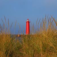 """""""Muskegon Pier Lighthouse""""<br /> <br /> Beautiful conical red lighthouse in Muskegon Michigan as seen through tufts of sand grass!! A scenic Lake Michigan lighthouse!!<br /> <br /> Lighthouses of the Great Lakes by Rachel Cohen"""