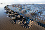 Striking erosion patterns in the sand at the mouth of Kalaloch Creek, Olympic National Park, Washington.