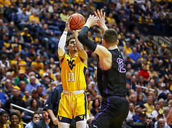 Mar 20, 2019; Morgantown, WV, USA; West Virginia Mountaineers forward Emmitt Matthews Jr. (11) shoots a three pointer during the second half against the Grand Canyon Antelopes at WVU Coliseum. Mandatory Credit: Ben Queen