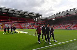 Burnley players inspect the pitch before the game