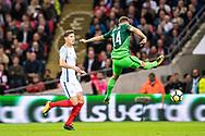 England (6) John Stones, Slovenia (14)Roman Bezjak during the FIFA World Cup Qualifier match between England and Slovenia at Wembley Stadium, London, England on 5 October 2017. Photo by Sebastian Frej.