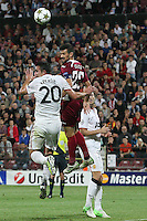 Ricardo Cadu (C) of CFR Cluj challenges Robin van Persie (L) of Manchester United during the UEFA Champions League, Group H, soccer match at Dr. Constantin Radulescu Stadium in Cluj-Napoca, Romania, 2 October 2012.