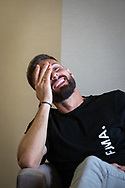 French footballer, Olivier Giroud, who plays for the Premier League club Chelsea and the France national team, talking about his Christian faith to French journalists, in the Chelsea Harbour Hotel, London, UK.