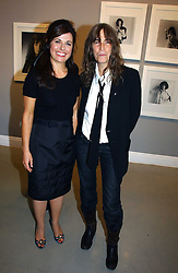 Left to right, ALISON JACQUES and rock star PATTI SMITH at an exhibition of photographs by the late Robert Mapplethorpe at the Alison Jacques Gallery, 4 Clifford Street, London W1 on 7th September 2006.<br />