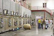 concrete vats group of visitors domaine sang des cailloux vacqueyras rhone france
