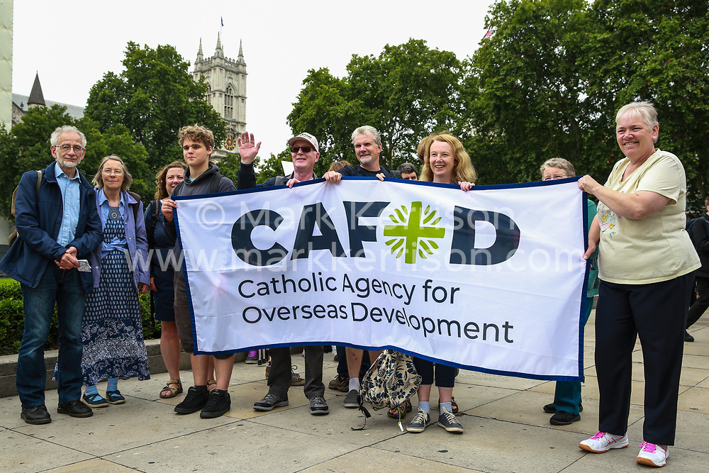 London, UK. 26 June, 2019. Climate change activists from CAFOD attend a mass lobby of Parliament for the climate and environment.