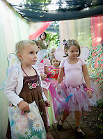 Madelyn McKenna and Molly Hazelton flutter through the magical forest during Cackleberries 5th annual Fairy Night in the Garden Friday evening.  (Karen Bobotas/for the Laconia Daily Sun)