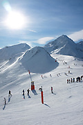 People skiing at the Peyragudes ski resort, Midi-Pyrenees, France.