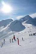 People skiing at the Peyragudes ski resort, Midi-Pyrenees, France.