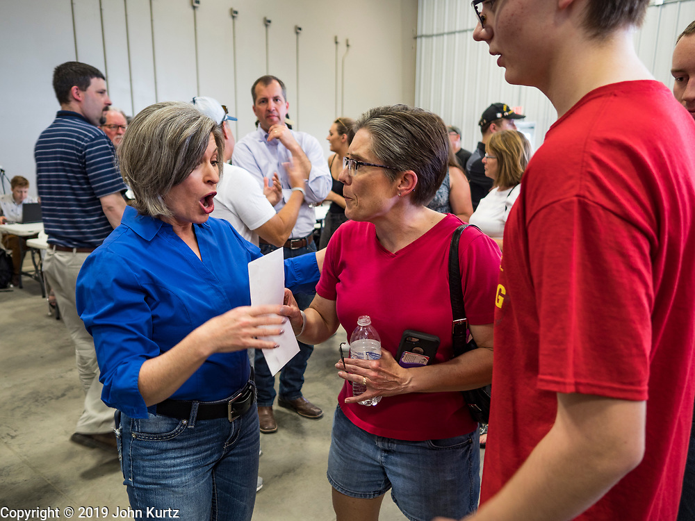 "15 JUNE 2019 - BOONE, IOWA: US Senator JONI ERNST (R-IA) talks to Iowa Republicans at ""Joni's Roast and Ride,"" a motorcycle ride / fund raiser hosted by Ernst. Ernst, Iowa's junior US Senator, kicked off her re-election campaign during the ""Roast and Ride"", an annual fund raiser and campaign event has she held since originally being elected to the US Senate in 2014.    PHOTO BY JACK KURTZ"