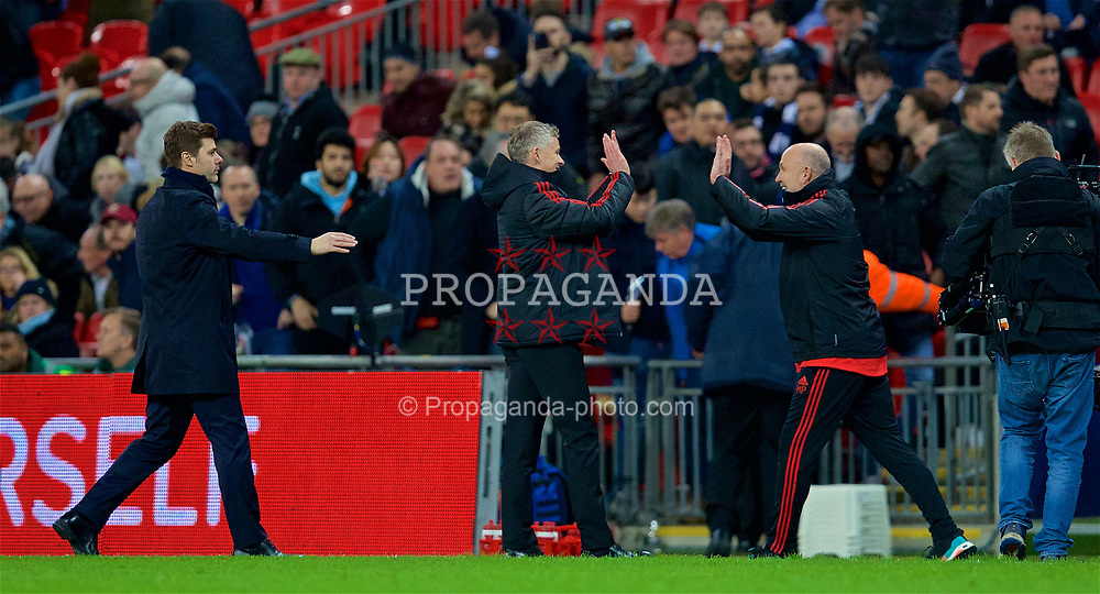 LONDON, ENGLAND - Sunday, January 13, 2019: Manchester United's manager Ole Gunnar Solskjær celebrates with assistant Mike Phelan at the final whistle, as Tottenham Hotspur's manager Mauricio Pochettino runs after him to shake hands, during the FA Premier League match between Tottenham Hotspur FC and Manchester United FC at Wembley Stadium. Manchester United won 1-0. (Pic by David Rawcliffe/Propaganda)