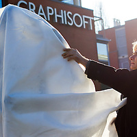 Sculptor Erno Toth covers the first ever life-size bronze statue of late Apple leader Steve Jobs he created with a white textile in its final place in front of the Graphisoft building in Budapest, Hungary on December 13, 2011. ATTILA VOLGYI