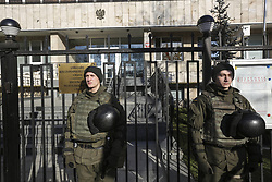 February 5, 2018 - Kiev, Kyiv region, Ukraine - National guards guard the Polish Embassy as activists of different nationalist parties protest against the bill about 'Bandera ideology' in front it in Kyiv, Ukraine, Feb. 5, 2018. Polish Sejm on 26 January voted for the bill setting a ban on promoting the so-called 'Bandera ideology,' with its historic roots stemming from Ukraine. The law also introduces criminal liability for those asserting that the Poles were collaborating with the Nazis during World War II. Ukrainian President Poroshenko believes that the law does not correspond with the proclaimed principles of strategic partnership between the two countries, as Ukrainian media report. (Credit Image: © Sergii Kharchenko/NurPhoto via ZUMA Press)