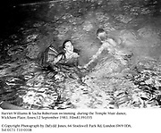 Harriet Williams & Sacha Robertson swimming  during the Temple Muir dance, Wickham Place, Essex. 12 September 1981. Film81391f35<br />