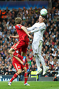 Champions League semi final second leg soccer match between Real Madrid and FC Bayern Munich at the Santiago Bernabeu stadium in Spain - <br /> MADRID 25/04/2012<br /> ESTADIO SANTIAGO BERNABEU.<br /> half final, Halbfinale, Semifinale,  CHAMPIONS LEAGUE<br /> REAL MADRID 2 - BAYERN 1<br /> picture: THOMAS MULLER. SERGIO RAMOS.- fee liable image, copyright © ATP QUEEN INTERNACIONAL<br /> <br /> Real MADRID vs Fc BAYERN Match 2:1 und 3:1 im Elfmeterschieflen - and 3:1 in penalty shooting - Queen photographer Fernando ALVAREZ