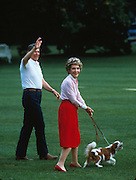 March 6, 2016 - NANCY REAGAN, Ronald Reagan's widow and First Lady from 1981-1989, has died at 94. The cause of death was congestive heart failure. Pictured: Dec 12, 1986. Washington, DC, U.S. - RONALD WILSON REAGAN with his wife NANCY leaving the White House for Camp David with their dog.<br /> ©Michael Evans/Exclusivepix Media