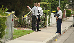 August 21, 2017 - Orange, CA, USA - Detectives meet on the sidewalk as police investigate a shooting that turned deadly in Orange, CA early Monday morning, August 21, 2017. (Credit Image: © Ken Steinhardt/The Orange County Register via ZUMA Wire)
