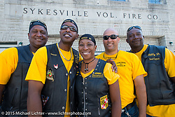 """(L>R) Jimmy McQuay, third generation Flying Eagles MC members Corey """"Jetson"""" Norris and his sister Terri Collins, Woody """"Scout"""" Davis and """"Billy D"""" Harris in front of the old fire department facade in Skyesville, MD while out riding with the Flying Eagles MC (founded 1950). USA. August 15, 2015.  Photography ©2015 Michael Lichter."""