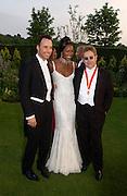 David Furnish, Naomi Campbell and Sir Elton John, Sir Elton John's White Tie and Tiara Ball. Windsor, 28 June 2003. © Copyright Photograph by Dafydd Jones 66 Stockwell Park Rd. London SW9 0DA Tel 020 7733 0108 www.dafjones.com