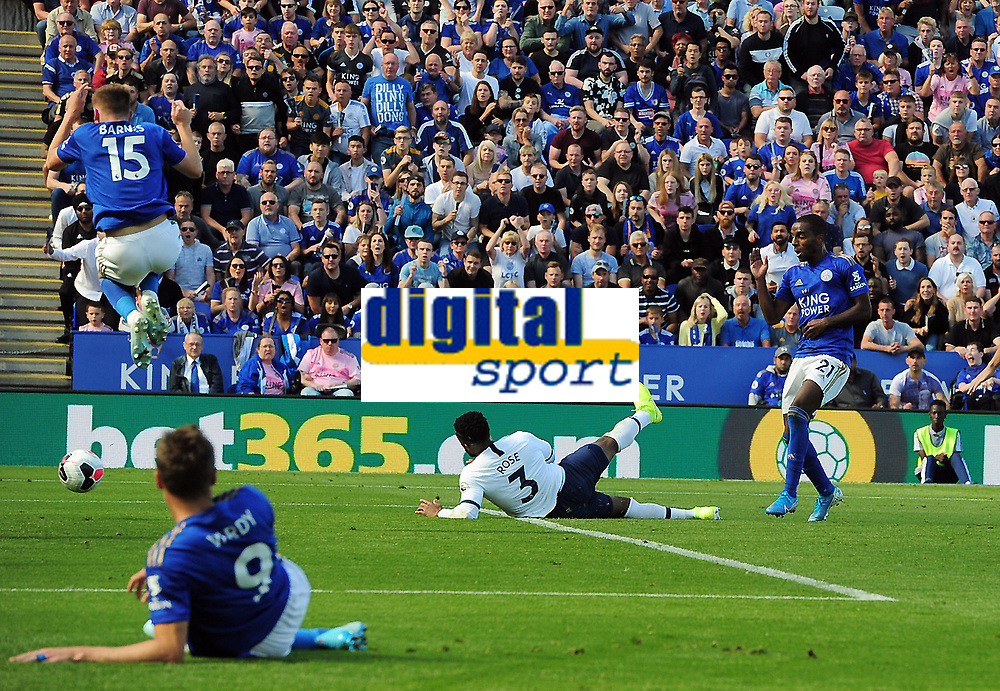 Football - 2019 / 2020 Premier League - Leicester City vs. Tottenham Hotspur<br /> <br /> Ricardo Pereira of Leicester shoots past Danny Rose for goal no 1, as Harvey Barnes jobs in the air to let the ball through at The King Power Stadium.<br /> <br /> COLORSPORT/ANDREW COWIE
